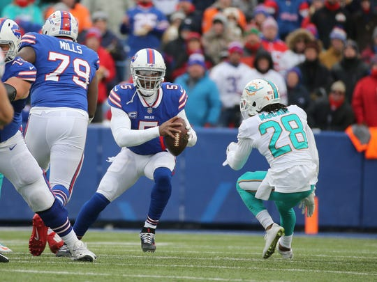 Bills quarterback Tyrod Taylor steps up in the pocket to avoid the blitz by Dolphin's Bobby McCain.