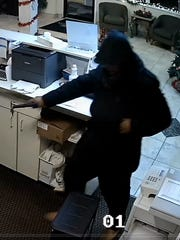 A surveillance video photo shows the suspect in an