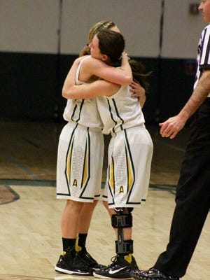 Ashwaubenon seniors Alicia Guarascio (left) and Annika Baeten (right) embrace on the Jaguars' Senior Night on Feb. 11. Baeten, who tore the ACL in her left knee in December, checked into the game and made a layup off an assist from Guarascio.