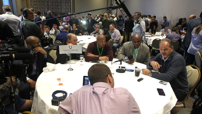 Colts coach Chuck Pagano, right, talks to the media at the NFL owners meeting in Boca Raton, Fla.
