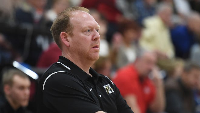 Winchester Coach Matt Fine leads the Falcons against Northeastern Friday, Feb. 17, 2017 during a basketball game in Fountain City.