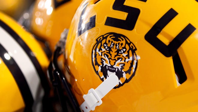 The LSU logo is seen on a helmet during the first half of an NCAA college football game in Baton Rouge, La., Saturday, September 6, 2014. (AP Photo/Jonathan Bachman)