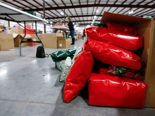 Presents wrapped by volunteers for families adopted