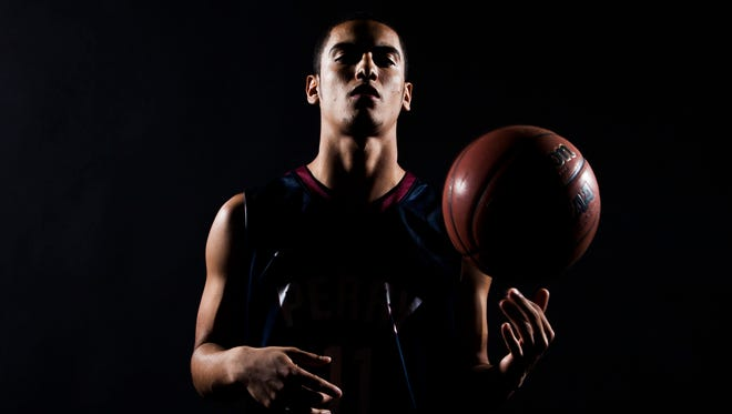 Gilbert Perry's Markus Howard poses for a photo in 2014.