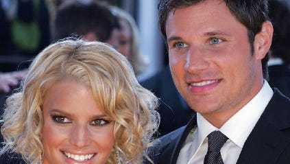 Jessica Simpson, left, and husband Nick Lachey arrive at the 31st Annual People's Choice Awards, Sunday, Jan. 9, 2005, in Pasadena, Calif. The couple in 2004. (AP Photo/Reed Saxon)