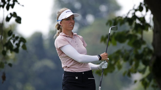 Sophia Popov, who lives in Germany and was raised in Framingham, follows through on her tee shot on the second hole during the final round of the Marathon Classic LPGA golf tournament on Aug. 9 at the Highland Meadows Golf Club in Sylvania, Ohio. Popov won the Women's British Open on Sunday.