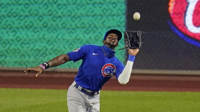 Chicago Cubs right fielder Cameron Maybin runs down a fly ball  in Pittsburgh on Wednesday.