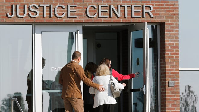 People enter the Arapahoe County Justice Center on the second day, April 28, 2015, of the trial of Aurora movie theater massacre defendant James Holmes in Centennial, Colo.