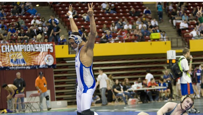 Sunnyside's Kory DeBerry celebrates his state title over Ironwood Ridge's David Wilson in the 145 pound weight Class 5A-II individual wrestling championships at Wells Fargo Arena in Tempe Feb. 17, 2010.