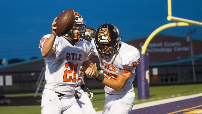 Ryle's Jake Chisholm celebrates after scoring against Campbell County last week. The Raiders are the new No. 1 team in the Enquirer Northern Kentucky coaches' poll.