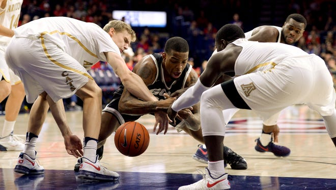 Dec 14, 2016: Grand Canyon Lopes forward Darion Clark (23) Arizona Wildcats forward Lauri Markkanen (10) (left) and guard Rawle Alkins (1) (right) battle for the ball during the first half at McKale Center.