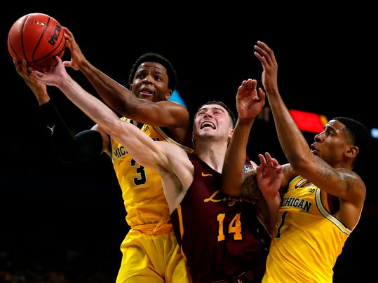 Loyola-Chicago guard Ben Richardson (14) fights for a rebound with Michigan guard Zavier Simpson, left, and Charles Matthews, right, during the second half in the semifinals of the Final Four NCAA college basketball tournament, Saturday, March 31, 2018, in San Antonio. Michigan won 69-57. (AP Photo/Charlie Neibergall)