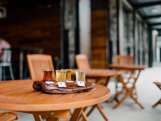 Tables, chairs and Cornhole are always set up on the patio at 1859! Cider Co.