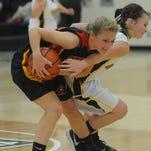 Northeastern's Tatum Jordan protects a rebound as Seton Catholic's Julia Reichley defends during Monday's game.