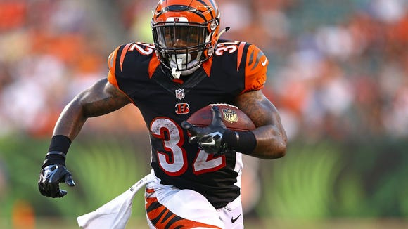 Jeremy Hill of the Cincinnati Bengals runs with the ball during the second quarter against the Indianapolis Colts at Paul Brown Stadium on August 28, 2014 in Cincinnati, Ohio. (Photo by Andy Lyons/Getty Images)