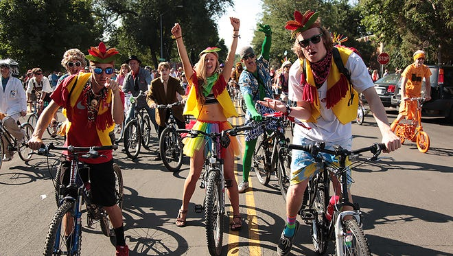 Particpants in New Belgium's 2014 Fort Collins Tour de Fat enjoy the parade Saturday morning in Old Town.