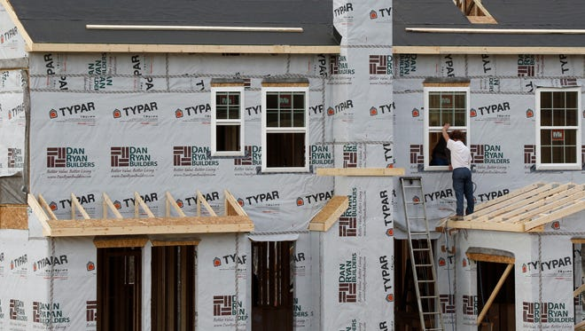 In this photo made on Friday, March 28, 2014, construction continues on a housing plan in Zelienople, Pa. The Commerce Department releases new home sales for March on Wednesday, April 23, 2014. (AP Photo/Keith Srakocic)