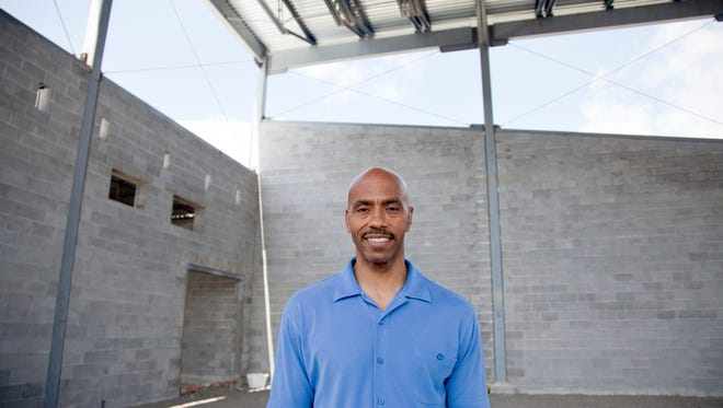 Former UofL champion and Utah Jazz basketball player, Darrell Griffith stands inside the Darrell Griffith Athletic Center while it's under construction at the West End School. June 17, 2014
