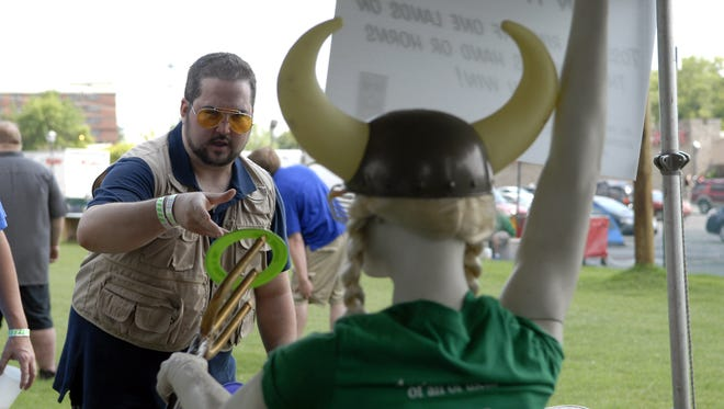 """Jason Williams, 27, of Indianapolis, plays the """"Put A Ring On It,"""" ring toss game at the Lebowski Fest Garden Party at the Executive Bowl Strike & Spare.  July 20, 2013"""