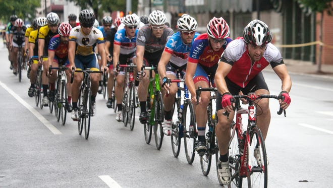 Andy Mudd leads several laps during the Category Four and Five portion of the New Albany Bicentennial Crit Bicycle Race. July 27, 2014