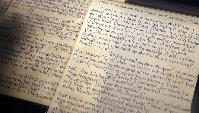 Some of the letters and poems from John Lennon which are to be auctioned at Sotheby's auction house are viewed on May 29, 2014 in New York City.