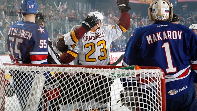 Adam Cracknell celebrates his first-period short-handed goal that gave the Wolves a 1-0 lead over the Amerks.