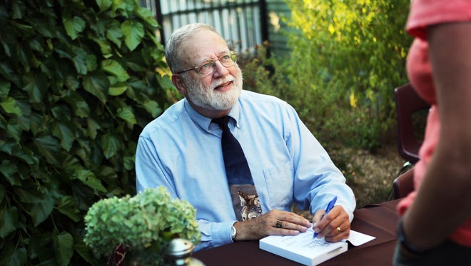 """Local author Ray Ballantyne signs a copy of his first published novel, """"The Last Child of Hamelin,"""" at A.C. Gilbert's Discovery Village. Ballantyne is a retired Salem-Keizer elementary school teacher."""