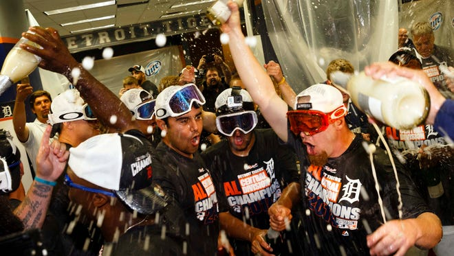 Tigers players celebrate after winning the AL Central Division title.