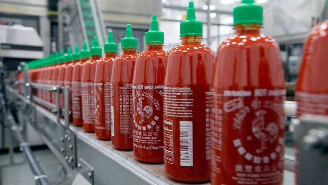 Sriracha chili sauce is produced at the Huy Fong Foods factory in Irwindale, Calif., in October.