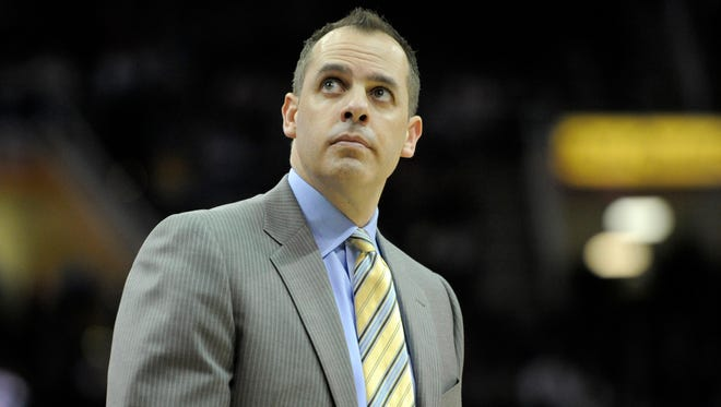 Indiana Pacers head coach Frank Vogel glances at the scoreboard in the fourth quarter against the Cleveland Cavaliers at Quicken Loans Arena.