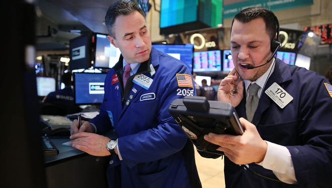 Traders on the floor of the New York Stock Exchange at the end of trading on Monday.