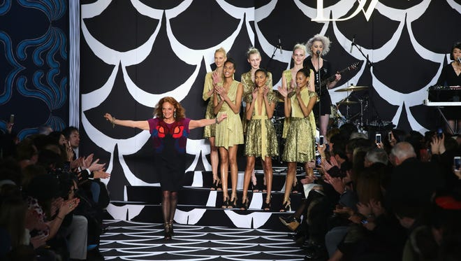 Diane von Furstenberg is joined by gold-clad models at her Fall 2014 show.