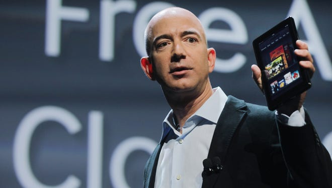 Amazon founder Jeff Bezos holds a Kindle Fire on September 28, 2011 in New York City. Amazon is said to be working on a TV set-top box that would run a similar version of Android as its Kindle Fire.