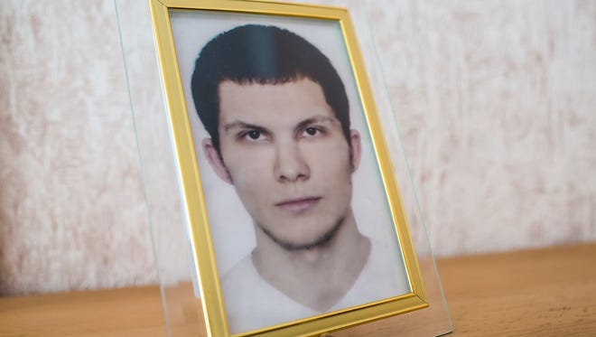 A photograph of Alexander Panin stands on a shelf in his grandmother's home on Tuesday in Tver, Russia.