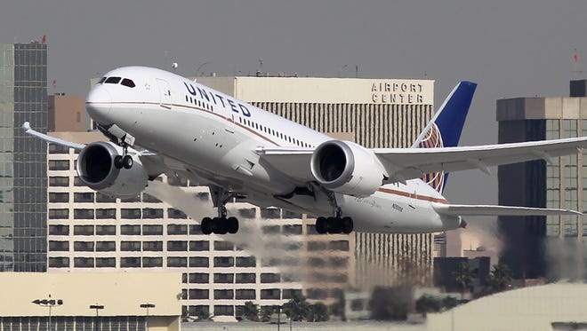 A Boeing 787 Dreamliner operated by United Airlines takes off at Los Angeles International Airport on Jan. 9, 2013. The Dreamliner was grounded for more than three months after jets owned by Japanese airlines had problems with their lithium-ion batteries.