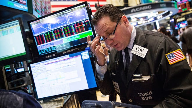 A trader works on the floor of the New York Stock Exchange in New York City.
