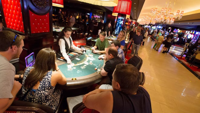 Patrons playing blackjack on the at The Cromwell Hotel and Casino as it opens for business in Las Vegas.