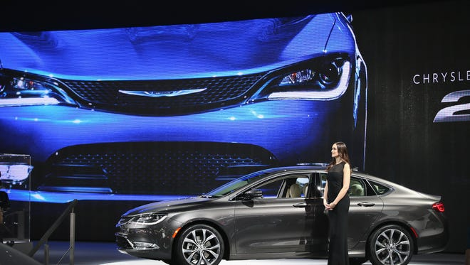 Shannon Folsom shows off the new Chrysler 200 C at the North American International Auto Show