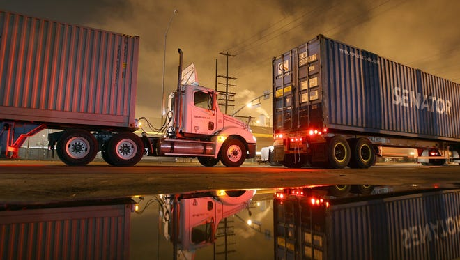 Trucking companies say new rules that limit drivers' hours are hurting productivity and raising costs.