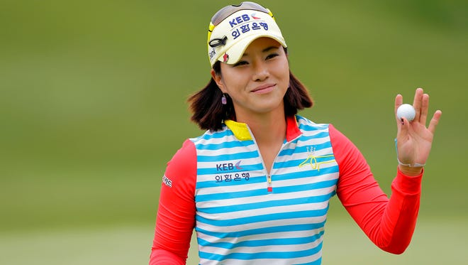 Hee Young Park of South Korea waves to the crowd on the ninth hole during the second round of the Kingsmill Championship presented by JTBC on the River Course at Kingsmill Resort in Williamsburg, Va.