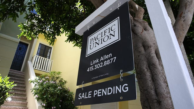 A sale pending sign is posted in front of a home for sale in San Francisco.