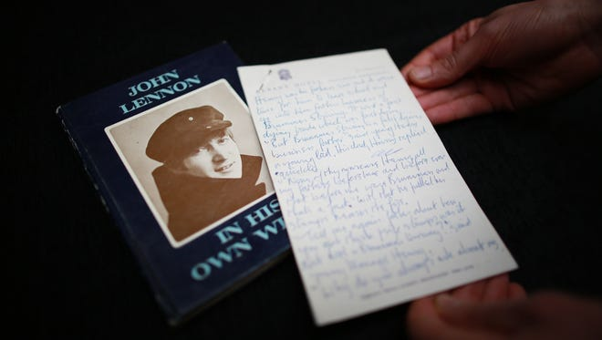 A hand written piece of prose by John Lennon for his book 'In His Own Write' is displayed at Sotheby's  in London.