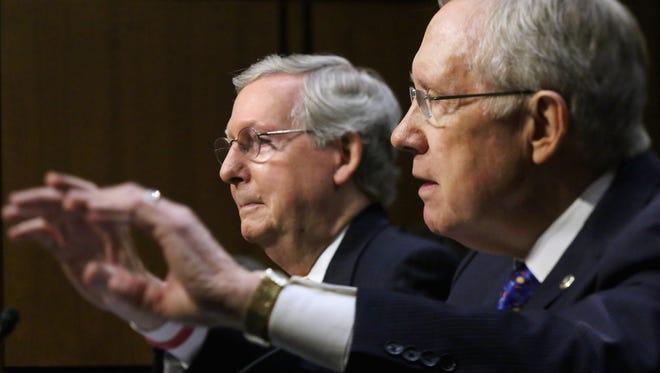Senate Republican leader Mitch McConnell, left, and Senate Majority Leader Harry Reid.