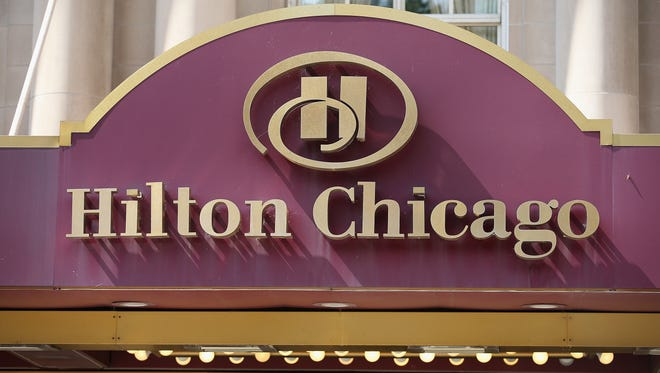 A sign hangs above the Hilton Hotel on Michigan Avenue in Chicago.
