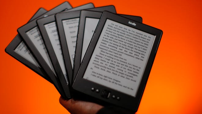 Kindle e-readers are seen at a press conference in 2012 in California.