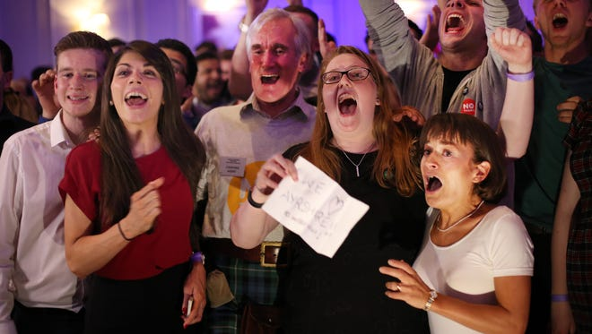 """Better Together"" campaigners celebrate poll results at a party Friday in Glasgow."