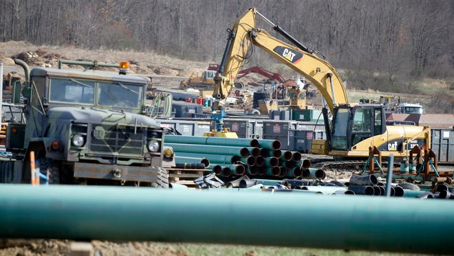 In this Thursday, April 17, 2014, photo, workers continue the construction at a gas pipeline site in Harmony, Pa.