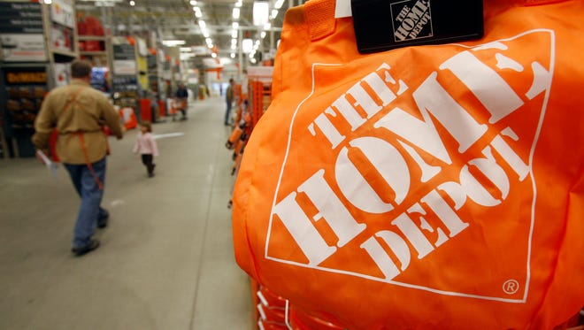 In this Feb. 22, 2010 file photo, shoppers walk through the aisles at the Home Depot store in Williston, Vt.