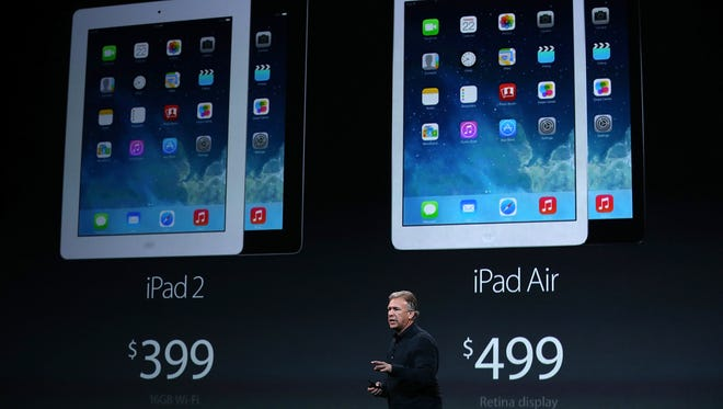 Apple's Phil Schiller announces the new iPad Air during an event at the Yerba Buena Center for the Arts in San Francisco, California.