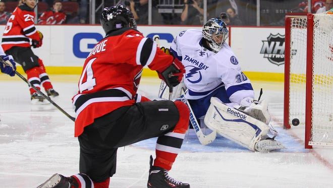 New Jersey Devils center Adam Henrique (14) scores a goal on Tampa Bay Lightning goalie Ben Bishop (30) during the second period at the Prudential Center.